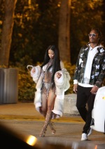Nicki Minaj wears a fur coat over a white bikini while filming new video in Miami Beach. Pictured: Nicki Minaj Ref: SPL1453030 270217 Picture by: KDNPIX Splash News and Pictures Los Angeles: 310-821-2666 New York: 212-619-2666 London: 870-934-2666 photodesk@splashnews.com