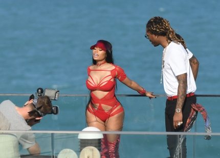 EXCLUSIVE: February 27, 2017: Nicki Minaj shows off her famous curves in a red cutout bodysuit as she films a video with rapper Future in Miami Beach, Florida. -PICTURED: Nicki Minaj, Future -PHOTO by: INSTARimages.com -Instar_Nicki_Minaj_Future_EXC_0730642214 Editorial Rights Managed Image - Please contact www.INSTARimages.com for licensing fee and rights: North America Inquiries: email sales@instarimages.com or call 212.414.0207 - UK Inquiries: email ben@instarimages.com or call + 7715 698 715 - Australia Inquiries: email sarah@instarimages.com.au Êor call +02 9660 0500 Ð for any other Country, please email sales@instarimages.com. ÊImage or video may not be published in any way that is or might be deemed defamatory, libelous, pornographic, or obscene / Please consult our sales department for any clarification or question you may have - http://www.INSTARimages.com reserves the right to pursue unauthorized users of this image or video. If you are in violation of our intellectual property you may be liable for actual damages, loss of income, and profits you derive from the use of this image or video, and where appropriate, the cost of collection and/or statutory damage.