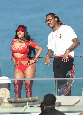 EXCLUSIVE: February 27, 2017: Nicki Minaj shows off her famous curves in a red cutout bodysuit as she films a video with rapper Future in Miami Beach, Florida. -PICTURED: Nicki Minaj, Future -PHOTO by: INSTARimages.com -Instar_Nicki_Minaj_Future_EXC_0730642221 Editorial Rights Managed Image - Please contact www.INSTARimages.com for licensing fee and rights: North America Inquiries: email sales@instarimages.com or call 212.414.0207 - UK Inquiries: email ben@instarimages.com or call + 7715 698 715 - Australia Inquiries: email sarah@instarimages.com.au Êor call +02 9660 0500 Ð for any other Country, please email sales@instarimages.com. ÊImage or video may not be published in any way that is or might be deemed defamatory, libelous, pornographic, or obscene / Please consult our sales department for any clarification or question you may have - http://www.INSTARimages.com reserves the right to pursue unauthorized users of this image or video. If you are in violation of our intellectual property you may be liable for actual damages, loss of income, and profits you derive from the use of this image or video, and where appropriate, the cost of collection and/or statutory damage.